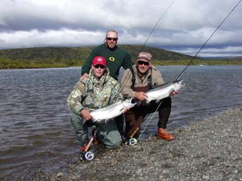 Father and Son Double up on a pair of Togiak River Silvers. Togiak River Lodge, Bristol Bay, Alaska